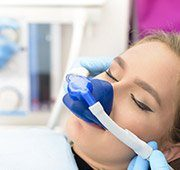 Woman with nitrous oxide nasal mask
