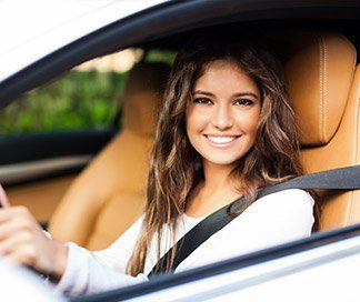 Smiling woman driving care